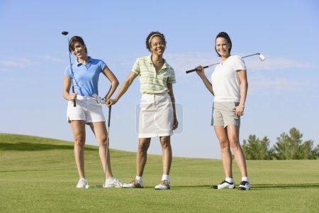 Portrait of three women on golf course