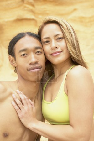 Portrait of couple hugging