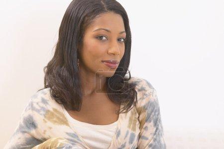 Studio shot of African woman smiling