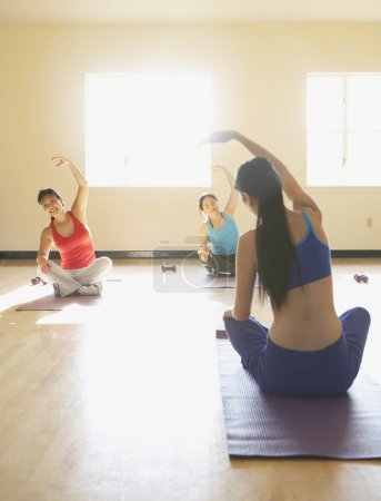 Young women practicing yoga
