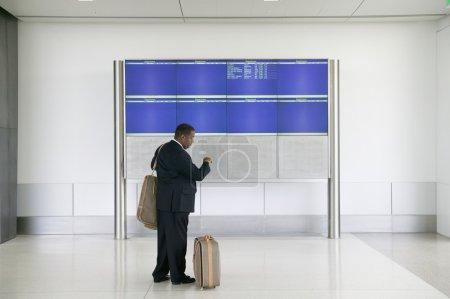 Businessman checking airline schedule