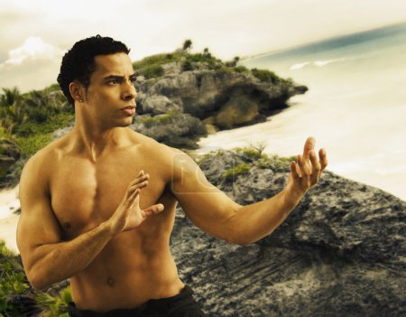 Mixed Race man practicing Tai Chi