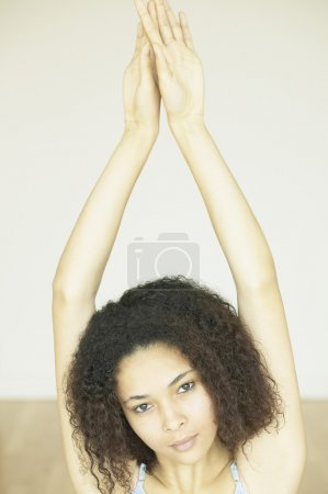 African woman with arms over head