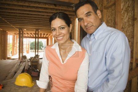 Portrait of Hispanic couple at construction site