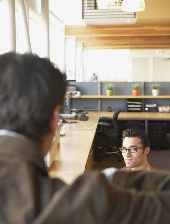 Businessmen in office space