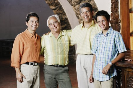 Male members of a family smiling for the camera