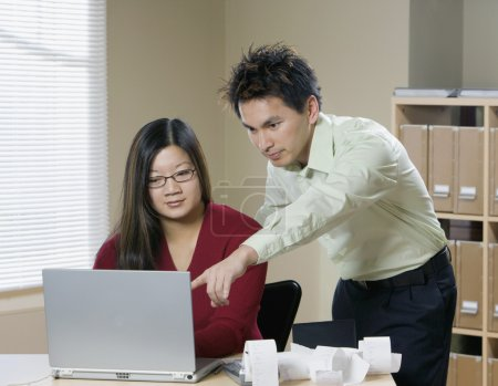 Businesspeople with laptop in office