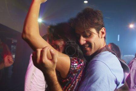 Hispanic couple dancing at nightclub