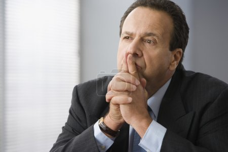Hispanic businessman thinking