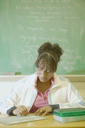 Teenage girl sitting in a classroom