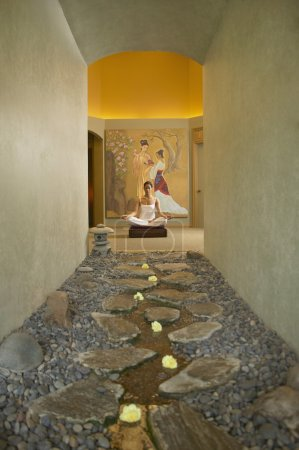 Woman meditating in spa room