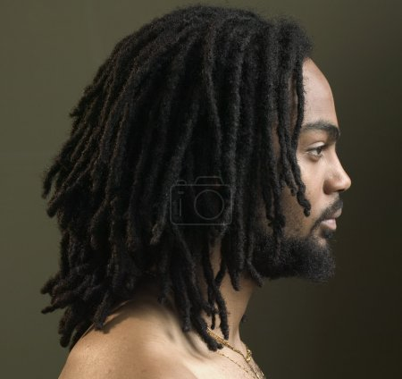 Profile of man with dreadlocks