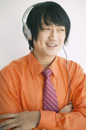 Businessman with headphones listening to music