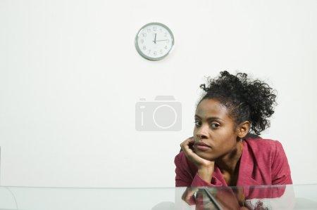Businesswoman sitting behind counter
