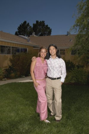 Portrait of couple in yard smiling