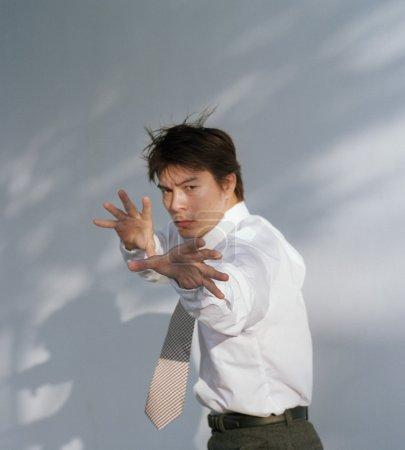 Businessman practicing martial arts