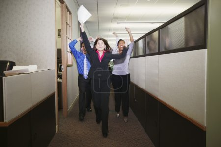 Businesspeople cheering in office