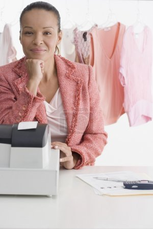 Portrait of woman at register in clothing store