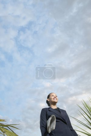 Low angle view of businesswoman