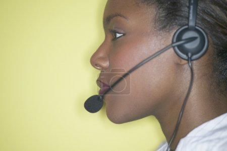 Close up profile of businesswoman with headset