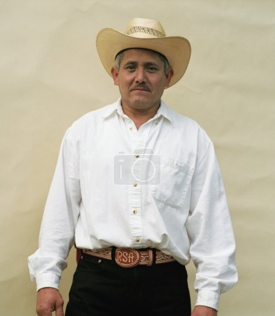 Middle-aged man wearing cowboy hat