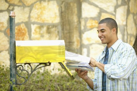 Man getting mail from mailbox