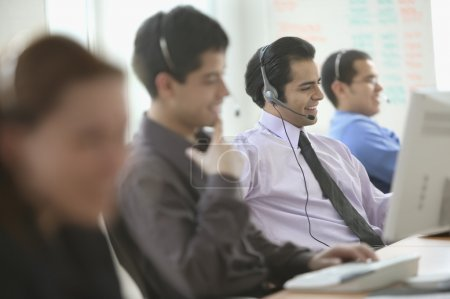 Call center workers on the job