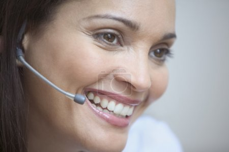 Close up of businesswoman with earpiece