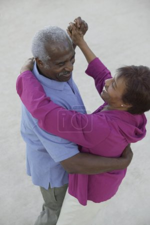 High angle view of a senior couple dancing together