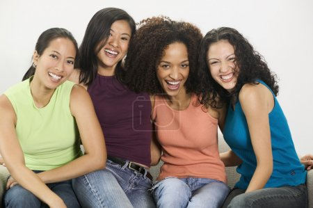 Group of young women looking at camera smiling