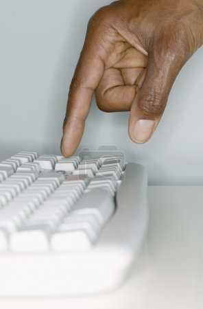 Close up of hand on computer keyboard
