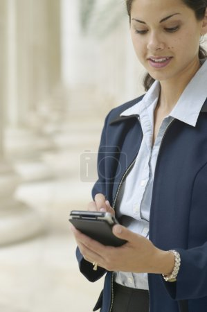 Businesswoman with electronic organizer