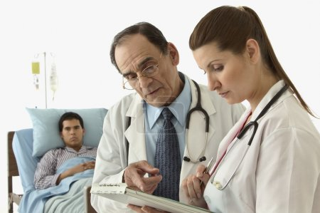 Doctors discussing a patient's medical chart