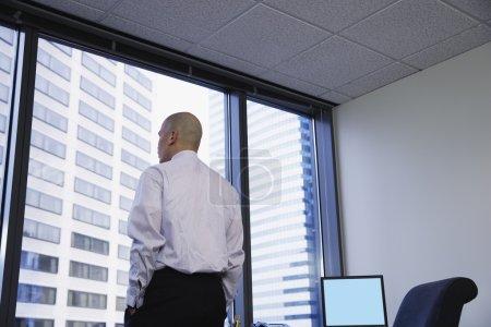 Businessman gazing out window