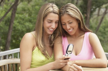 Two young women looking at a mobile phone