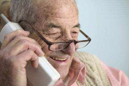 Elderly man talking on cell phone
