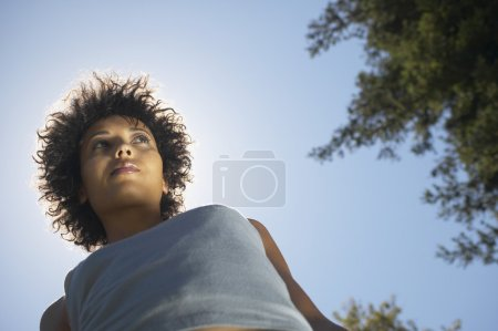 Low angle view of African American woman outdoors