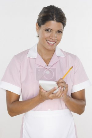 Portrait of waitress taking order