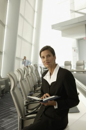 Businesswoman with day timer in conference room