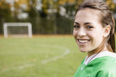 Portrait of girl smiling on soccer field