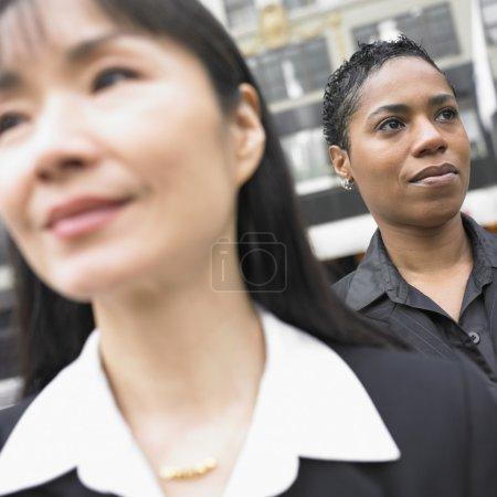 Close up of businesswomen standing