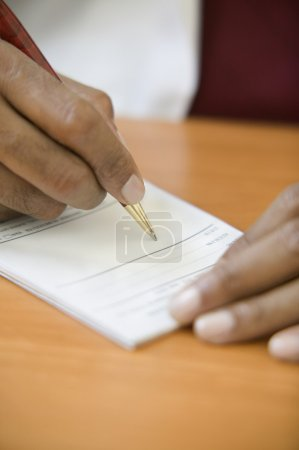 Close up of hand writing prescription