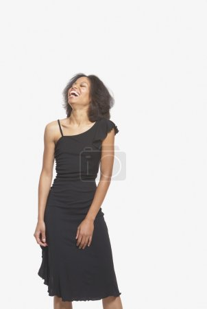 Woman in black gown laughing