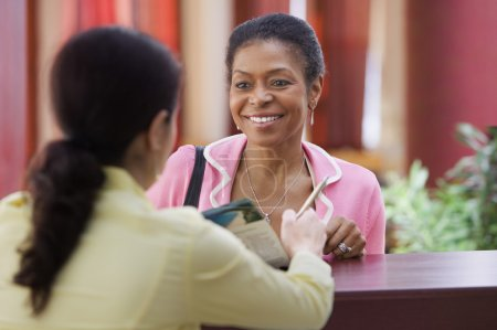 Woman talking to a receptionist
