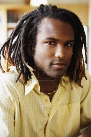 Portrait of man with dread locks