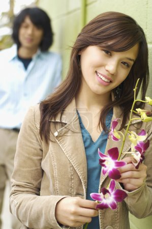 Young woman posing for the camera with flowers