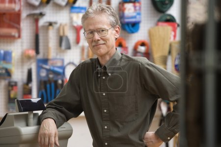 Mature man smiling for the camera in hardware store