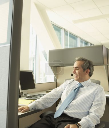 Businessman using a headset at his desk