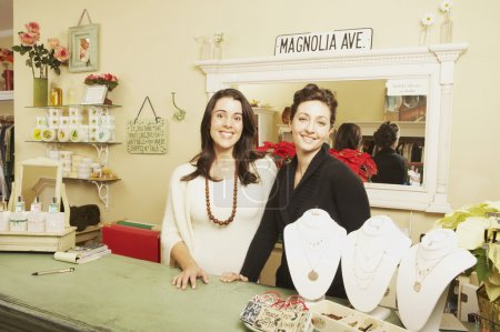 Two businesswomen behind the counter at a boutique