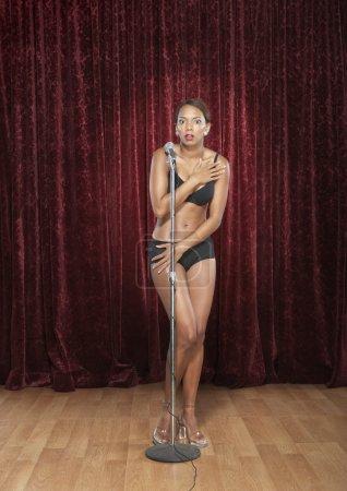 Woman in her underwear onstage